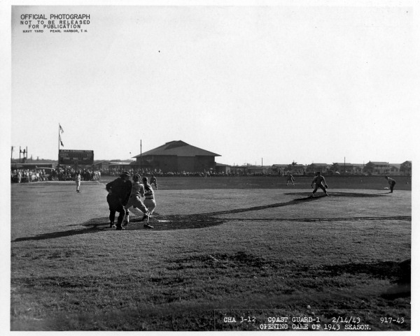 The opening game of the 1943 baseball season at Furlong Field. This diamond would see dozens of baseballs brightest and best don their spikes and military-team flannels to entertain the troops stationed in Hawaii during WWII.