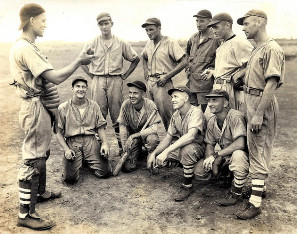 GI Baseball team in the South Pacific. More than likely, these men are either USMC or Navy personnel. The reverse of this image has hand-inscribed list of names of the players pictured.