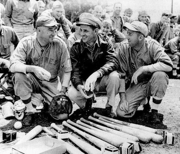 Big Leaguers Jim Bivin (left) and Cal Dorsett (right), playing for the 2nd Marine Division team in the Pacific in 1945, are visited by former Braves outfielder-turned USAAF 1st Lt. Tom Winsett at center (source: baseballinwartime.com).