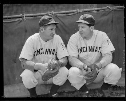 Catcher Ernie Lombardi (left) is pictured in his road gray Reds uniform in 1939 (as noted by the baseball centennial patch on his left sleeve).