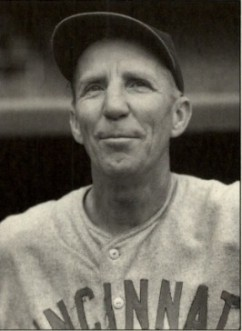 Hank Gowdy (ca. 1940) is wearing his road gray Reds jersey with the same block lettering (sans serif) but it lacks piping. This uniform was worn by the Reds through the end of WWII (Photo: Charles Conlon).
