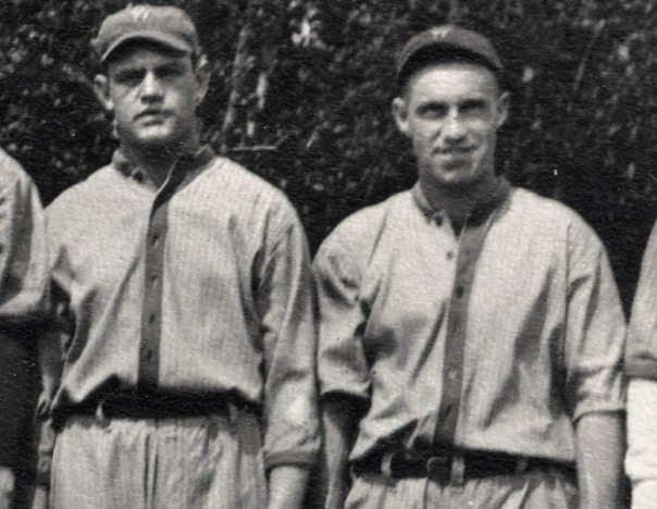This style of collar began to appear with the New York Giants in 1906 and became more commonplace by 1911 across most teams. The 3/4 sleeve was a departure from the full-length long sleeves of the late 19th century. These uniforms also feature pinstripes and a darker material that follows the button strip and continues upward and around the collar.