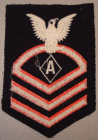 "Note that this Specialist ""A"" CPO rating badge is fully embroidered which would typically date this as a post-war example. Earlier examples would typically have wool chevrons sewn onto the base material."