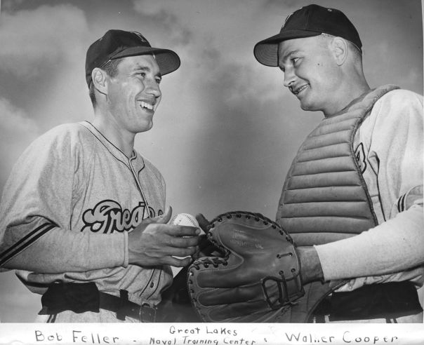 Chief Feller (left) meets with his catcher, Walter Cooper at the Great Lakes Naval Training Center.